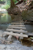 Bridge over the waterfall. A wooden bridge crosses the stream Stock Photos