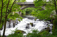 Bridge over waterfalls Royalty Free Stock Photo