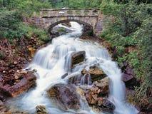 Bridge over waterfalls stock images