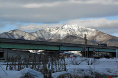 Bridge over white snow field. White snow cover mountain and field in Nagano Japan Stock Photos