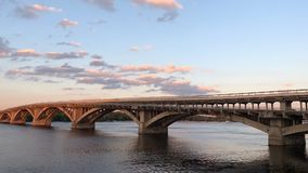 Bridge over a wide river. The Dnieper River in Kiev, view of the `Bridge stock footage