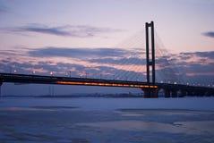 Bridge over winter river Stock Photos