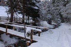 Bridge over winter river Stock Image