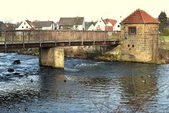 Bridge over the wooden river. Going on a wooden bridge over the river on a winter day. royalty free stock photo
