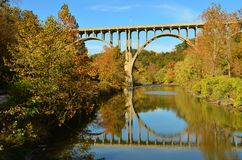 Bridge overpass and reflection on lake in Autumn. In Cuyahoga Valley Royalty Free Stock Photos