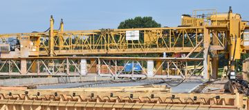 A bridge overpass under construction awaits concrete. A bridge overpass under construction over Interstate 85 in Greenville County SC USA is ready for concrete Royalty Free Stock Photos