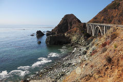 The  bridge on the Pacific coast of the USA. The coastal highway and a bridge on the Pacific coast of the USA Stock Images