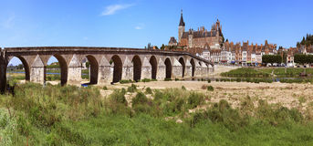 Bridge. Panorama of an old deck of a castle and a city on a river Royalty Free Stock Photo
