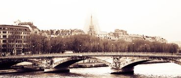Bridge in Paris. ? high contrast sepia with a faint view of the Eiffel Tower Royalty Free Stock Image