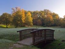 Bridge in the park. Little bridge in the park under early morning Sun Royalty Free Stock Photos