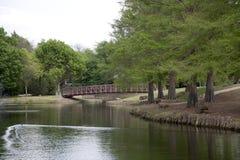 Bridge in spring community park Royalty Free Stock Photo