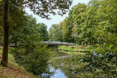 Bridge in the park. Bridge over the stream in the park of the Spa town of Bad Kissengen, Germany Stock Photo