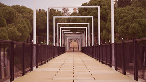 Bridge in a park. Vanishing point Royalty Free Stock Photography