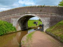 Canal bridge with lock. Bridge with part of the top gate of a canal lock on the Shropshire Union Canal near Audlem in Cheshire, England Royalty Free Stock Images
