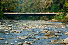 Bridge passing over a mountain river Stock Images