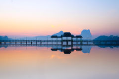 Bridge and pavilion on lake at sunrise park. Hpa-An, Myanmar Royalty Free Stock Image