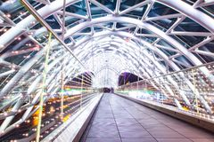 The Bridge of Peace is a bow-shaped pedestrian bridge, a steal and glass construction illuminated with numerous LEDs. Over the Kura River in downtown Tbilisi stock photography