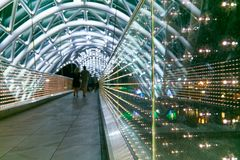 Bridge of Peace. Steel and glass construction. The Bridge of Peace is a bow-shaped pedestrian bridge, a steel and glass construction illuminated with numerous stock photo