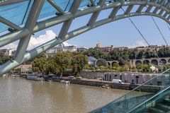 The bridge of peace over the Kura river in Tbilisi royalty free stock images
