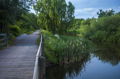 Bridge for pedestrians and bikers next to the river. Nature just outside of the city Stock Photos