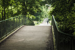 Bridge for pedestrians and bikers. Using a bike on a sunny summer day Stock Images