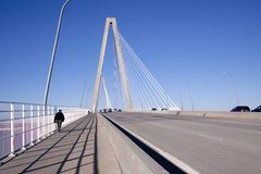Bridge with pedestrians and traffic stock images