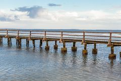 Bridge or pier across an expanse of sea Royalty Free Stock Images