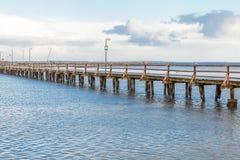 Bridge or pier across an expanse of sea Stock Photos