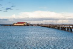 Bridge or pier across an expanse of sea Royalty Free Stock Photography