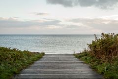 Bridge or pier across an expanse of sea Royalty Free Stock Photography