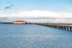 Bridge or pier across an expanse of sea Stock Photography