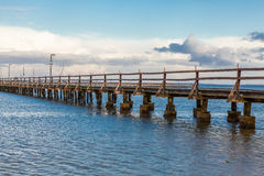 Bridge or pier across an expanse of sea Stock Images