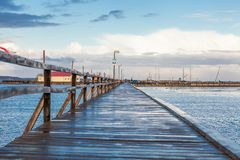 Bridge or pier across an expanse of sea Royalty Free Stock Photos