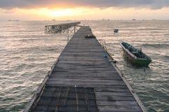 Bridge of pier in the beach at sunset stock photo