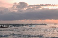 Bridge of pier in the beach at sunset stock photography