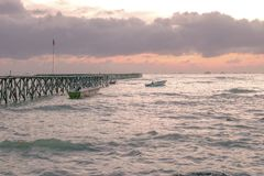 Bridge of pier in the beach at sunset royalty free stock photos