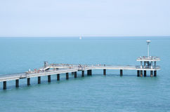 A bridge with a pier and jumping and walking people Burgas, Bulg. A bridge with a pier and jumping and walking people in the summer Burgas, Bulgaria Royalty Free Stock Photography