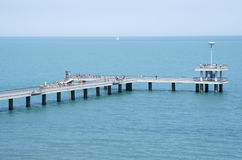 A bridge with a pier and jumping and walking people Burgas, Bulg. A bridge with a pier and jumping and walking people in the summer Burgas, Bulgaria Stock Photography