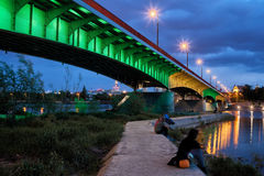 Bridge and Pier on Vistula River in Warsaw at Night Stock Image