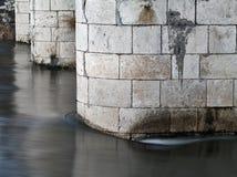 Bridge pillars. With flowing water around them Stock Images