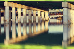 Bridge Pillars And Reflections Royalty Free Stock Images