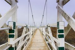 The bridge at Point Bonita Lighthouse on a foggy day, Marin Headlands, San Francisco bay area, California royalty free stock photos