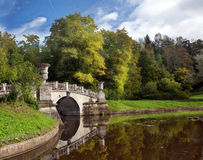 The bridge and pond in the autumn in Pavlovsk park Royalty Free Stock Image