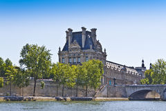 Bridge Pont du Carrousel and famous museum Louvre Royalty Free Stock Photos