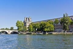 Bridge Pont du Carrousel and famous museum Louvre Stock Photos