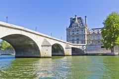 Bridge Pont du Carrousel and famous museum Louvre Stock Photo