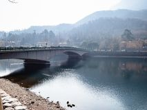 Bridge Ponte John Fitzgerald Kennedy in Lecco city. Travel to Italy - bridge Ponte John Fitzgerald Kennedy through Como Lake in Lecco city, Lombardy royalty free stock images