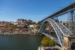 Bridge Ponte Luís I in Porto. Summer in Portugal. Lighthouse in Europe. River of Tejo royalty free stock image