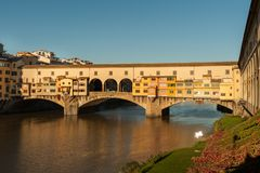 Bridge Ponte Vecchio in Florence on a sunny day in autumn. Bridge Ponte Vecchio in Florence Italy on a sunny day in autumn Royalty Free Stock Image