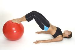 Bridge Pose 6. A female fitness instructor demonstrates the finishing position of the yoga bridge pose using a fitball Stock Images
